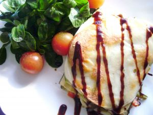 Vegetable timbale with lettuce salad and cherry tomatoes