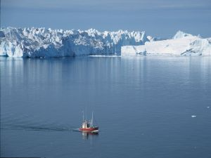 Boat sailing near a ice fjord in Greenland