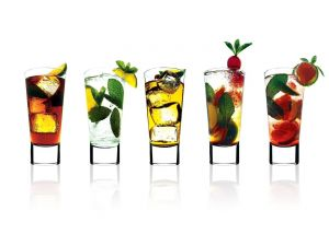 Glasses with infusions, fruits and mint leaves