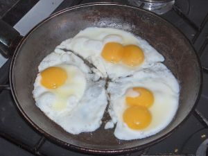 Five eggs fried in a pan