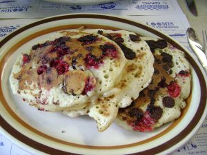 Pancakes with chocolate chips and raspberry