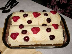 Argentine Sweet Pionono, fruit filling with whipped cream