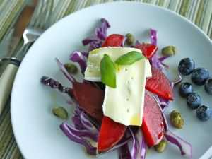Salad with cheese, red cabbage and fruits