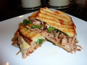 Grilled sandwich with meat, cheese and vegetables