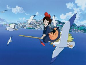 Niki flying on a broom with her cat