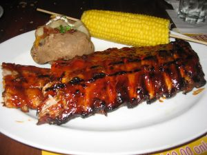 BBQ ribs, corn cob and baked potato