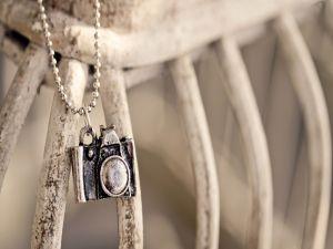 Pendant of a photo camera