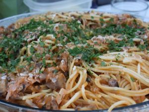 Dish of spaghetti with mushrooms and parsley