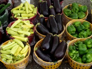 Baskets with eggplants and peppers