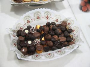 Tray with bombons and fruits coated