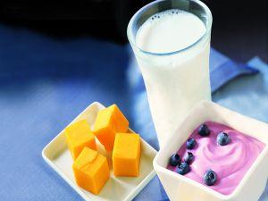Milk, yogurt with blueberries and diced mango