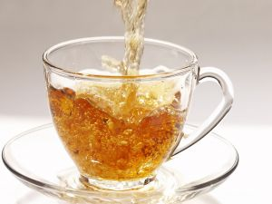 Tea jet falling into the bowl