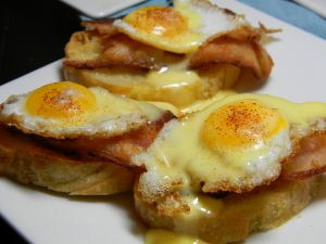 Slices of bread with bacon and quail eggs