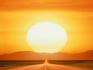 Big sun at the end of the road