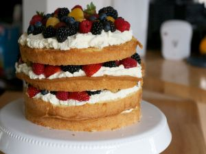 Layer cake with cream and red berries