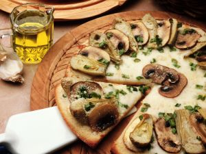 Pizza with mushrooms and artichokes
