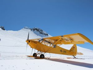 Piper PA-18 landing on the glacier Trient (Switzerland)