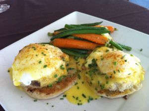 Eggs Benedict with carrots and beans