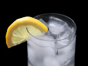 Glass of ice water with lemon