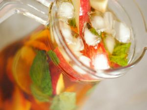 Ice tea pitcher with apple and mint
