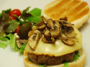 Burger cooked with mushrooms and cheese