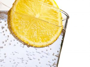 Sparkling water and a slice of lemon
