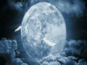 The Moon between clouds