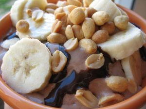 Chocolate ice cream with bananas and peanuts