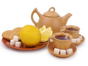 Tea, lemons and sugar cubes