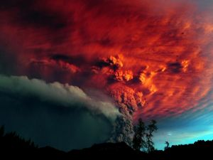 Red smoke cloud caused by an erupting volcano