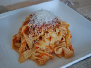 Ribbons of fresh pasta with tomato and parmesan