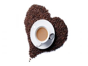 Cup over a coffee beans heart