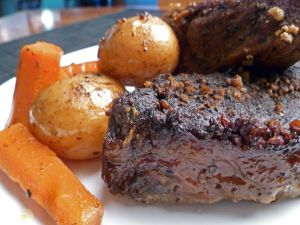 Rib roast with carrots and potatoes