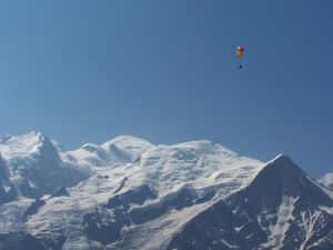 Paragliding over snowy peaks