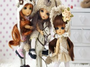 Three dolls with a little horse