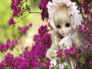 Doll between azaleas
