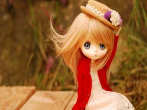Doll with an elegant hat