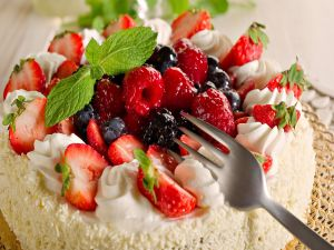 Cake with fresh red berries