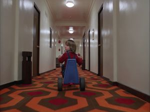 Danny on a tricycle through the halls of the Overlook Hotel (The Shining)
