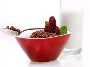 Chocolate cereals, raspberries and milk