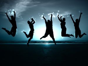 Boys and girls happy on a beach