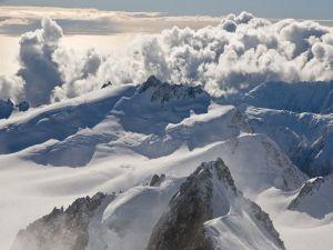 Big clouds over snowy peaks