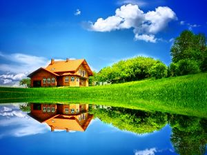 House reflected in the waters of the lake
