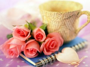 Roses, a notebook and a cup