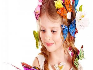 Girl with flowers and butterflies in her hair