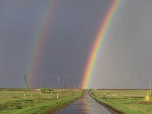 Rainbow at end of road