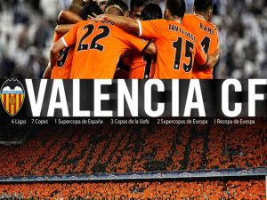 Valencia CF players together in an embrace