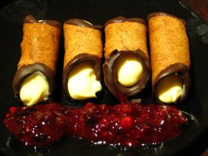 Cannoli with chocolate, vanilla and jam