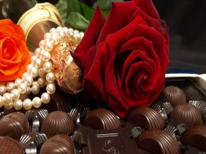 Pearls, champagne, roses and chocolates