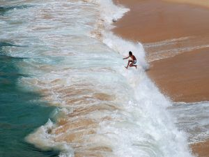 A boy playing in the waves (Porto Covo, Portugal)
